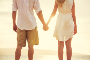 Young couple holding hands thanks to online relationship help